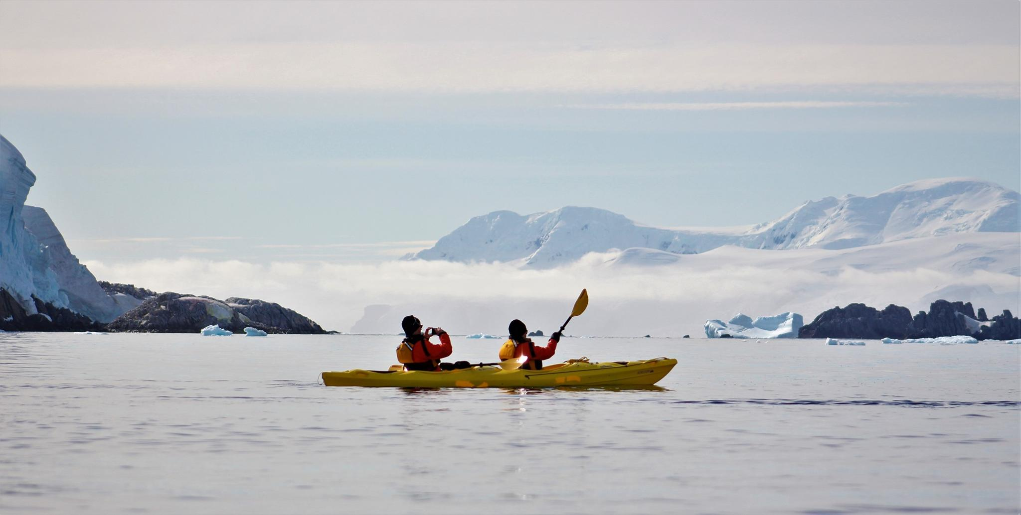 KAYAKING ANTIQUE KAYAK GREENLAND TAKING PILOT ABOARD